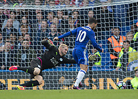 Football - 2016/2017 Premier League - Chelsea V Leicester.<br /> <br /> Eden Hazard of Chelsea rounds Kasper Schmeichel of Leicester City to score Chelsea's second goal at Stamford Bridge.<br /> <br /> COLORSPORT/DANIEL BEARHAM