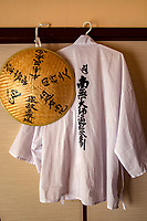 Hakui are white vests worn by henro pilgrims on the Shikoku Henro Pilgrims Trail.  They are usually worn with a sugegasa sedge hat, to protect the pilgrims from the elements.  Also part of the henro kit are staffs kongozue and bells jirei and even a wagesa stole though the basic henro jacket and hat are the basic norm.