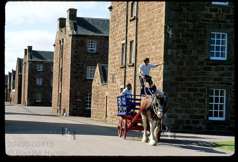 Guide takes visitors on horse-cart tour past garrison buildings inside 42-acre Fort George, built in mid 1700s; Ardesier, Scotland.