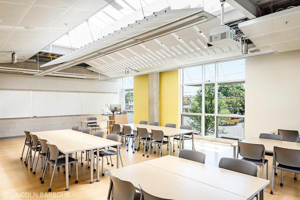 An empty room inside of PCC East Campus is being filled with natural light from the large windows and skylights.
