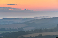 Dawn over Hannington Tower and Watership Down from Beacon Hill, Berkshire Downs.