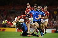 James King of Wales is brought to ground by his tackler. Rugby World Cup 2015 pool A match, Wales v Uruguay at the Millennium Stadium in Cardiff, South Wales  on Sunday 20th September 2015.<br /> pic by  Andrew Orchard, Andrew Orchard sports photography.