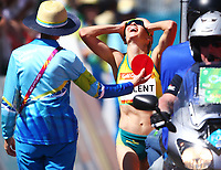 Aussie Clare Tallent reacts in dismay when receiving her final red card to be disqualified on day four of the Women's 20km Walk event during the Gold Coast 2018 Commonwealth Games in Australia.