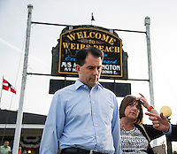 Wisconsin Governor Scott Walker walks down the ramp towards the M/S Mt Washington for the Belknap County Republican Cruise on Friday evening.  (Karen Bobotas/for the Laconia Daily Sun)