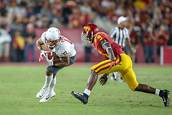 September 21, 2018 - Los Angeles, CA, U.S. - LOS ANGELES, CA - SEPTEMBER 21: Washington State Cougars wide receiver Dezmon Patmon (12) catches the ball for a gain in a game between the Washington State Cougars and the USC Trojans on September 21, 2018, at Los Angeles Memorial Coliseum in Los Angeles, CA. (Photo by Jordon Kelly/Icon Sportswire) (Credit Image: © Jordon Kelly/Icon SMI via ZUMA Press)