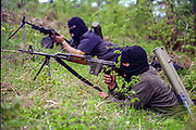 Ethnic Albanian gunmen from both sides of the borders in the Mjak village of Debelldeh southern Kosovo, showing off their arms force as they are set to remove the new border markings in a joint effort on Thursday, April 24, 2008. (Film 35mm Photo by Vudi Xhymshiti)
