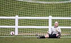 Edinburgh University's keeper Mark Tait fumbles Edinburgh City's Ian McFarland shot for their goal.<br /> Half time : Edinburgh University 0 v 1 Edinburgh City, Scottish Sun Lowland League game played 14/3/2015 at The University of Edinburgh's Peffermill playing field.