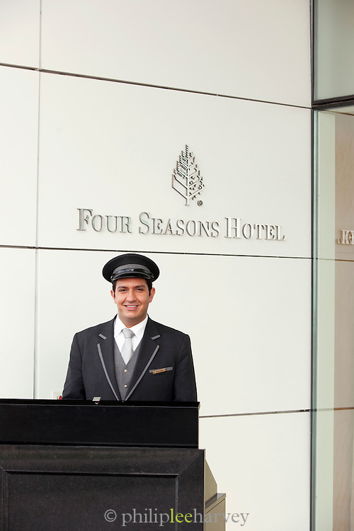 A concierge outside luxury Four Seasons hotel on the Corniche in Beirut, Lebanon