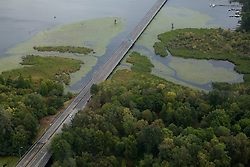 North America, United States, Washington,  Seattle, aerial view of highway through urban wetlands and bridge across Lake Washington