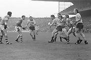 Players surround each other during the All Ireland Senior Gaelic Football Final, Kerry v Dublin in Croke Park on the 28th September 1975. Kerry 2-12 Dublin 0-11.