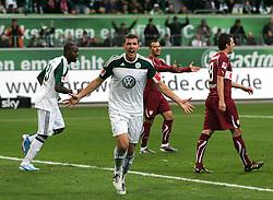 30.10.2010, Volkswagen Arena, Wolfsburg, GER, 1. FBL, VfL Wolfsburg vs VfB Stuttgart, im Bild Torjubel durch Edin Dzeko (Wolfsburg #9) EXPA Pictures © 2010, PhotoCredit: EXPA/ nph/  Schrader+++++ ATTENTION - OUT OF GER +++++