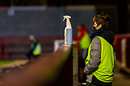 A ball boy on santising duty at the EFL Sky Bet League 2 match between Crawley Town and Walsall at The People's Pension Stadium, Crawley, England on 16 March 2021.