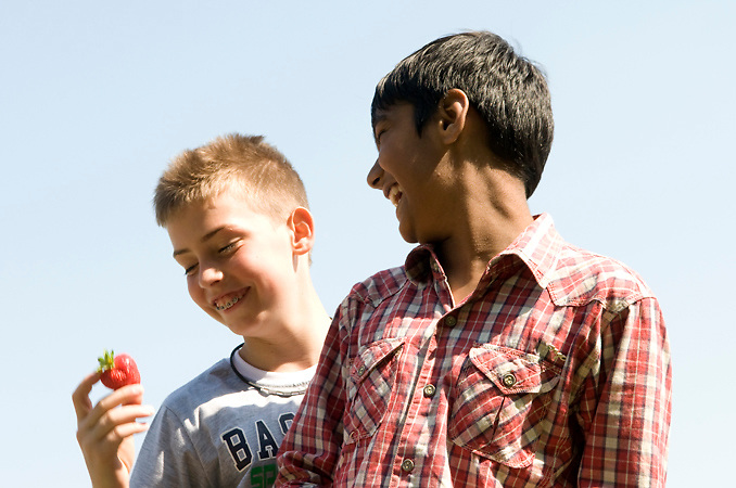Portrait of two boys during a lesson about agriculture in a educational urban farm