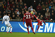 Roberto Firmino of Liverpool ® attempts an overhead kick at goal. Premier league match, Swansea city v Liverpool at the Liberty Stadium in Swansea, South Wales on Monday 22nd January 2018. <br /> pic by  Andrew Orchard, Andrew Orchard sports photography.