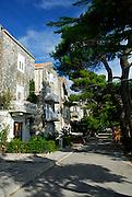 Promenade and houses along Eastern shore, Korcula old town, island of Korcula, Croatia