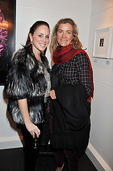 Left to right, CAVAN MAHONY and ARIANE SODI at a Private View of Bruno Bisang 30 Years of Polaroids held at The Little Black Gallery, 13A Park Walk, London SW10 on 15th January 2013.