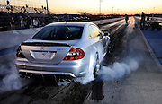 Mercedes CLK 6.3 AMG smoking tires at Thunder Valley Raceway drag strip in Noble, Oklahoma during test and tune practice.