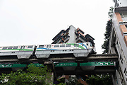 A CRT Chongqing Rapid Transit monorail approaches a station thats built directly into several floors of an apartment building in Chongqing, China, on Thursday, April 14, 2016. The municipality of 30 million people saw state-led development approach fueled the fastest pace nationwide, with President Xi Jinping praising policy innovations that have included subsidized housing and relaxed residency rules that encourage labor mobility.