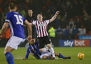 Sheffield United midfielder John Fleck (4) is fouled by Sheffield Wednesday midfielder Joey Pelupessy (8)  during the EFL Sky Bet Championship match between Sheffield United and Sheffield Wednesday at Bramall Lane, Sheffield, England on 9 November 2018.