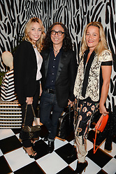 Left to right, JEANNE MARINE, hairdresser MASSATO and TARA AGACE at the Mother Of Pearl, Polly Morgan & Sunday Times Style Hosted London Fashion Week Pop-Up Shop at The Shop at Bluebird, Kings Road, London on 12th September 2013.