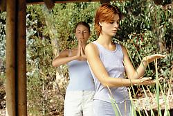 Jul. 25, 2012 - Two women practising yoga and tai chi (Credit Image: © Image Source/ZUMAPRESS.com)