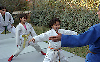Norwegin judotrainers are visiting Kabul as a part of the Judo for fred (judo for peace) program. Here some girls at the orphanage, Khorasan in, are practesing judo in the garden. (fall 2006)....Norske judoinstruktører besøker Kabul ifm Judo for fred (JFF). Her trener noen av jentene på Khorasan barnehjem judo ute i hagen (Høsten 2006).