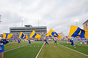 Dec 1, 2012; Tulsa, Ok, USA; Tulsa Hurricanes cheerleaders run flags before a game against the University of Central Florida Knights at Skelly Field at H.A. Chapman Stadium. Tulsa defeated UCF 33-27 in overtime to win the CUSA Championship. Mandatory Credit: Beth Hall-USA TODAY Sports