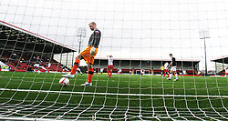 Airdrie United's keeper Robbie Thomson picks the ball after Falkirk's Lyle Taylor celebrates scoring their goal..Airdrie United 0 v 1 Falkirk, 30/3/2013..©Michael Schofield..