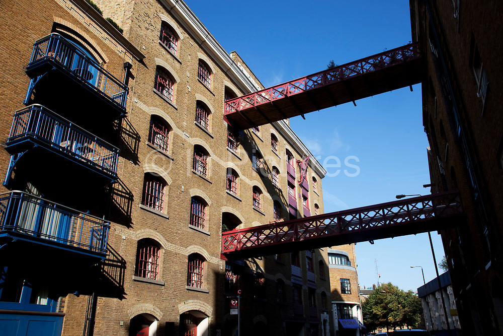 Gantry across the road at a wharf building on Wapping High Street in the East End of London. These were once working wharves.