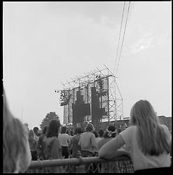 The Grateful Dead Concert at Dillon Stadium on 31 July 1974. B&W Original Film Scan. Photograph taken with a Hasselblad Camera with Tri-X film. View of onlooking Fans and Wall of Sound. The Dead are onstage and the concert has begun.