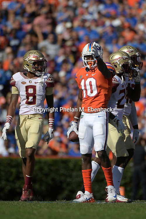 Florida wide receiver Josh Hammond (10) signals ahead after gaining a first down on a pass completion during the first half of an NCAA college football game against Florida State Saturday, Nov. 25, 2017, in Gainesville, Fla. (Photo by Phelan M. Ebenhack)