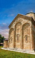 Pictures & images of Nikortsminda ( Nicortsminda ) St Nicholas Georgian Orthodox Cathedral exterior and its Georgian relief sculpture stonework of the west wall, 11th century, Nikortsminda, Racha region of Georgia (country). A UNESCO World Heritage Tentative Site. .<br /> <br /> Visit our MEDIEVAL PHOTO COLLECTIONS for more   photos  to download or buy as prints https://funkystock.photoshelter.com/gallery-collection/Medieval-Middle-Ages-Historic-Places-Arcaeological-Sites-Pictures-Images-of/C0000B5ZA54_WD0s<br /> <br /> Visit our REPUBLIC of GEORGIA HISTORIC PLACES PHOTO COLLECTIONS for more photos to browse, download or buy as wall art prints https://funkystock.photoshelter.com/gallery-collection/Pictures-Images-of-Georgia-Country-Historic-Landmark-Places-Museum-Antiquities/C0000c1oD9eVkh9c