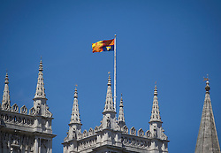 © Licensed to London News Pictures. 04/06/2013. London, UK. The Royal Standard is seen flying from a flagpole on the roof of Westminster Abbey in London today (04/06/2013) as Her Majesty the Queen attends a service celebrating the anniversary of her coronation. Photo credit: Matt Cetti-Roberts/LNP