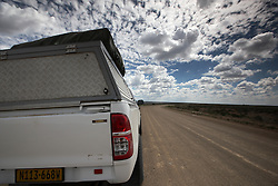 NAMIBIA SOSSUSVLEI APR14 - <br /> <br /> Toyota Hilux 4x4 vehicle with roof tent (bakkie) on a gravel road in Namibia.<br /> <br /> jre/Photo by Jiri Rezac<br /> <br /> <br /> <br /> © Jiri Rezac 2014
