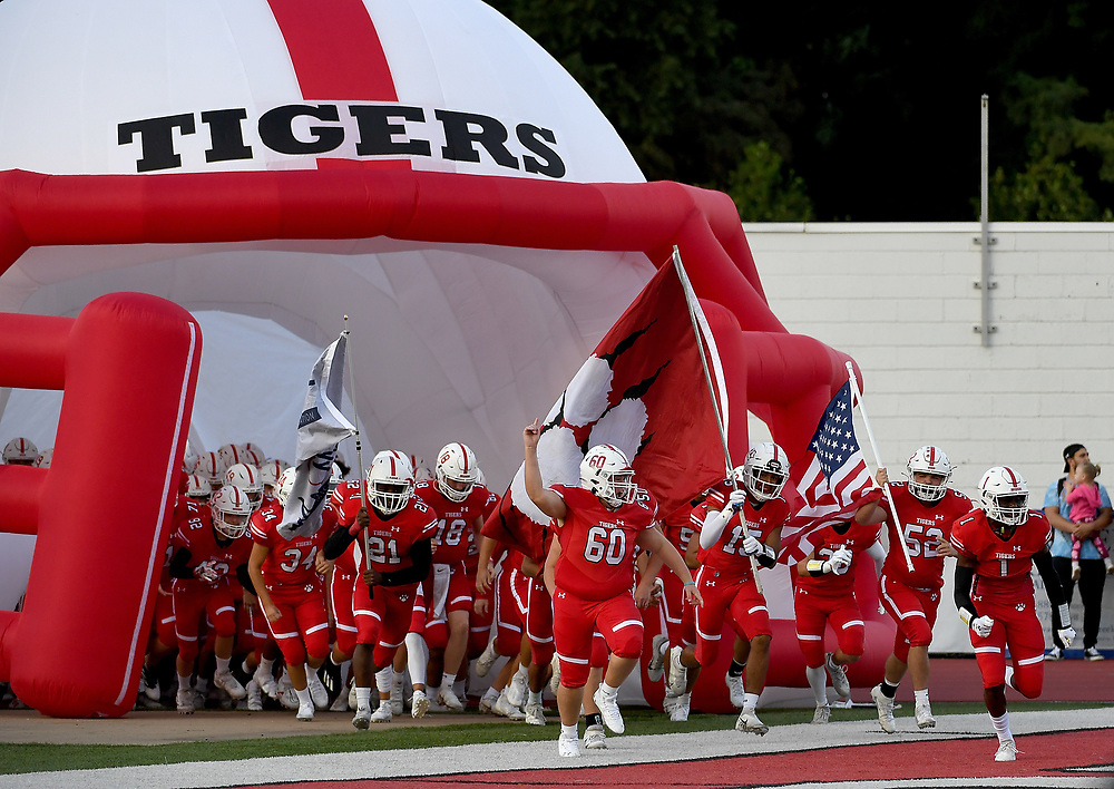 The Moon Tiger take the field for the game against the Montour Spartans at Tiger Stadium on September 3, 2021 in Moon Township, Pennsylvania.