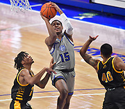St Louis Billikens guard Demarius Jacobs (15) drives to the basket between Arkansas-Pine Bluff Golden Lions players Dequan Morris (23, left) and Nicholas Jones (40, right). St. Louis University hosted the University of Arkansas - Pine Bluff in a mens basketball game on December 5, 2020 at Chaifetz Arena on the SLU campus in St. Louis, MO.<br /> Photo by Tim Vizer