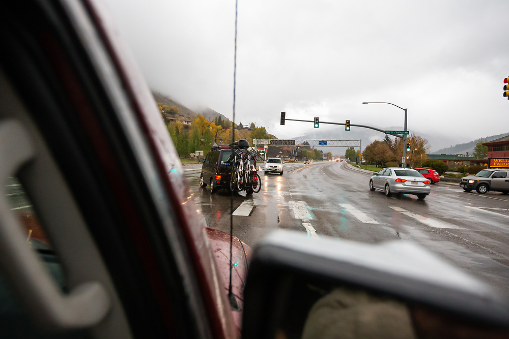 Heather Goodrich and Andrew Whiteford drive along Highway 22 after an autumn mountain biking session as the rain begins to come down.