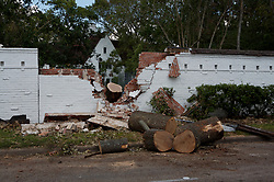 Stock photo of a brick wall damaged by a falling tree during Hurricane Ike