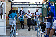 Men  from the local community wait to take part in a Fight for Peace Adult Boxing training session.  Fight for Peace project, Woolwich, London. UK.
