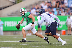 Oct 9, 2021; Huntington, West Virginia, USA; Marshall Thundering Herd quarterback Grant Wells (8) is chased out of the pocket by Old Dominion Monarchs defensive end Deeve Harris (31) during the first quarter at Joan C. Edwards Stadium. Mandatory Credit: Ben Queen-USA TODAY Sports