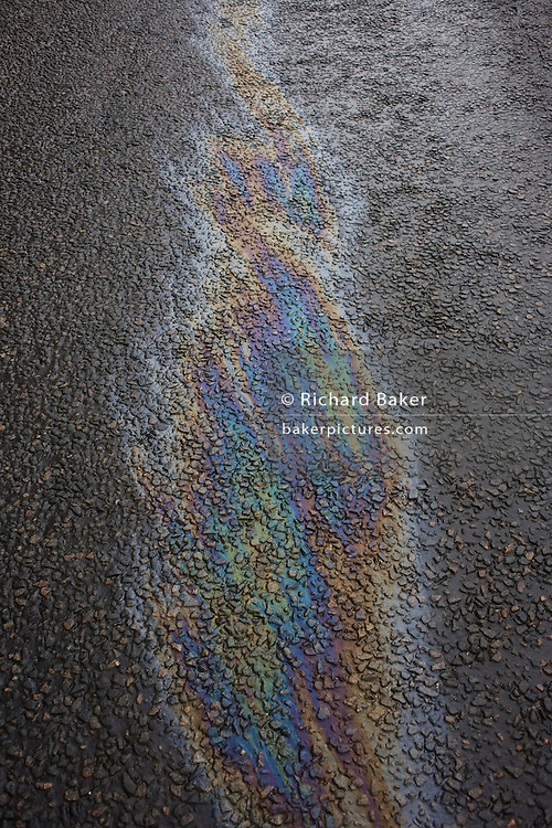 Chromatic colours on road surface tarmac in Oban, Scotland.