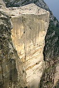 A side view reveals a long vertical crack in the Pulpit (Prekestolen), 1959 feet above Lysefjord, in Forsand municipality, Rogaland county, Ryfylke traditional district, Norway, Europe. The nearest city is Jørpeland, in Strand municipality. 1981 photo.