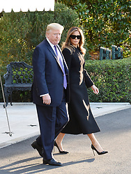 U.S. President Donald Trump and First Lady Melania Trump, depart the White House for Joint Base Andrews, en route to Las Vegas, Nevada Oct. 4, 2017. The President and the First Lady will visit with civilian heroes and first responders from the deadliest mass shooting in U.S. history. Photo by Olivier Douliery/ Abaca Press