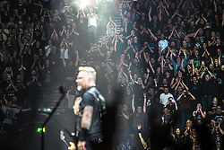 © Licensed to London News Pictures . 28/10/2017 . Manchester , UK . The audience watch James Hetfield in the foreground. Metallica perform at the Manchester Arena . Photo credit : Joel Goodman/LNP