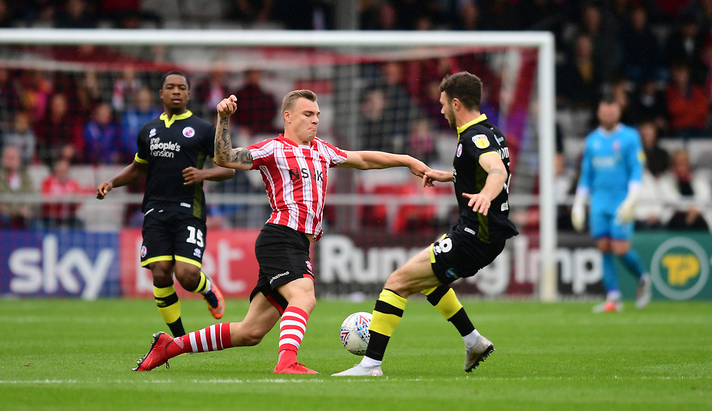 Lincoln City's Harry Anderson vies for possession with Crawley Town's Joe Maguire<br /> <br /> Photographer Chris Vaughan/CameraSport<br /> <br /> The EFL Sky Bet League Two - Lincoln City v Crawley Town - Saturday September 8th 2018 - Sincil Bank - Lincoln<br /> <br /> World Copyright © 2018 CameraSport. All rights reserved. 43 Linden Ave. Countesthorpe. Leicester. England. LE8 5PG - Tel: +44 (0) 116 277 4147 - admin@camerasport.com - www.camerasport.com