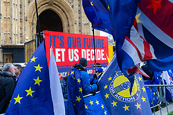 """A moving billboard demanding a second referendum, known as a """"People's Vote"""", drives past the Houses of Parliament as MPs debate and later vote on Prime Minister Theresa May's Brexit Deal. London, January 15 2019."""