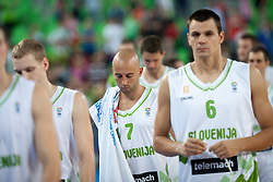 Sad slovenian players after friendly match between National teams of Slovenia and France for Eurobasket 2013 on August 31, 2013 in Arena Stozice, Ljubljana, Slovenia. (Photo by Matic Klansek Velej / Sportida.com)