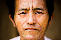 A portrait of Wa Meng Ha at his home in Khon Kahndone Village, Xieng Khouang province, Laos.