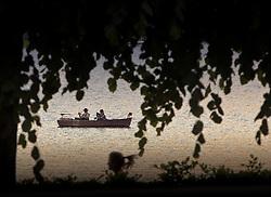 30.05.2011, Zeller See, Zell am See, AUT, THEMENBILD ANGLER IM BOOT, im Bild zwei Männer sitzen entspannt beim Angeln in einem kleinen Boot und warten bis ein Fisch die Köder beisst // Feature Two men sit relaxed while fishing in a small boat and wait until a fish bites the bait, EXPA Pictures © 2011, PhotoCredit: EXPA/ J. Feichter