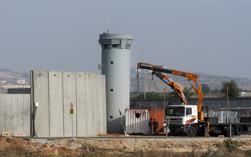 Construction crews work on part of the Israeli Security Fence along the Wet Bank in Israel, November 5, 2003. ..Photo by Erin Lubin